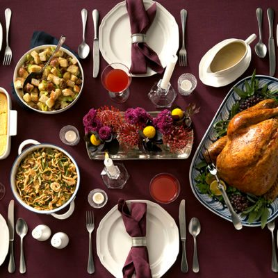 Image of traditional Thanksgiving table with classic Thanksgiving dishes.