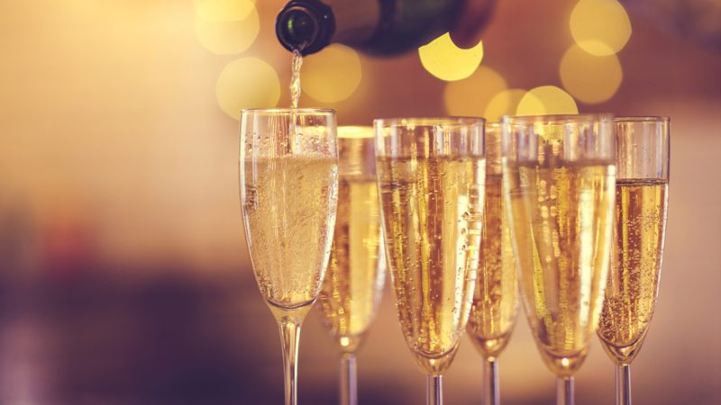 Champagne glasses on gold background.