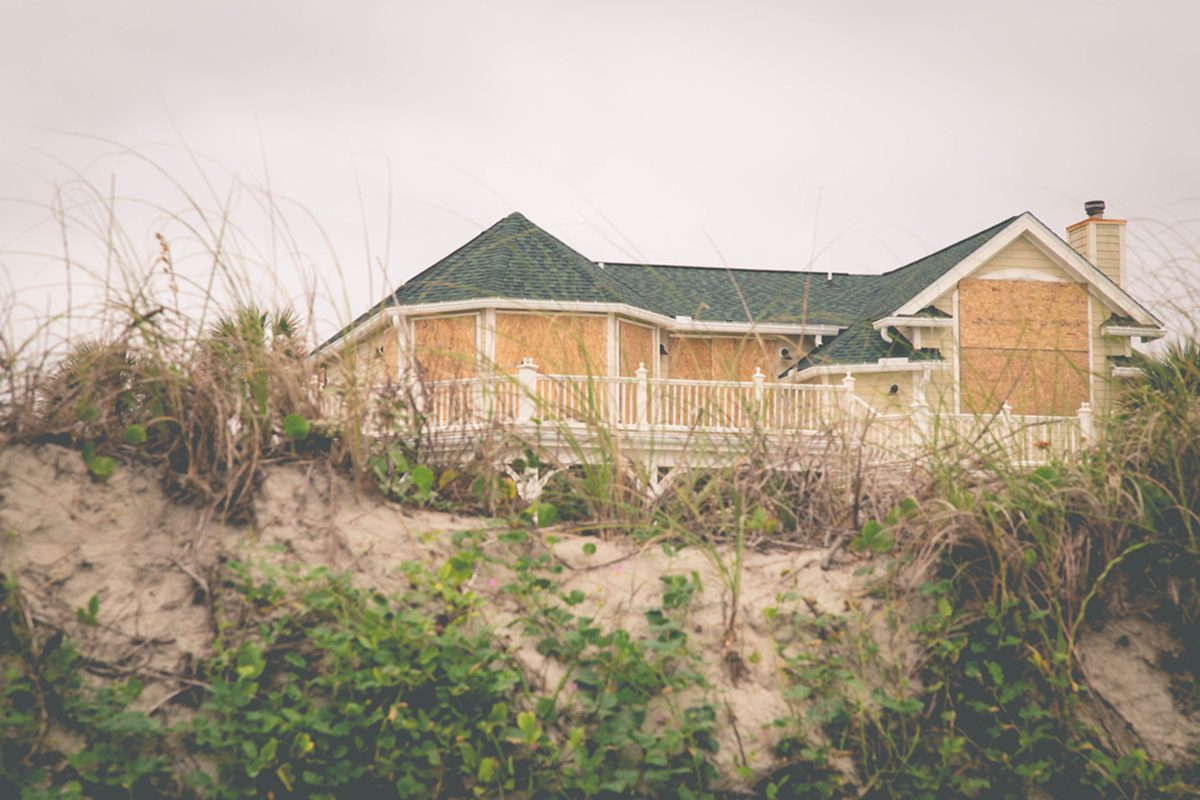 House on the beach boarded up for a hurricane.