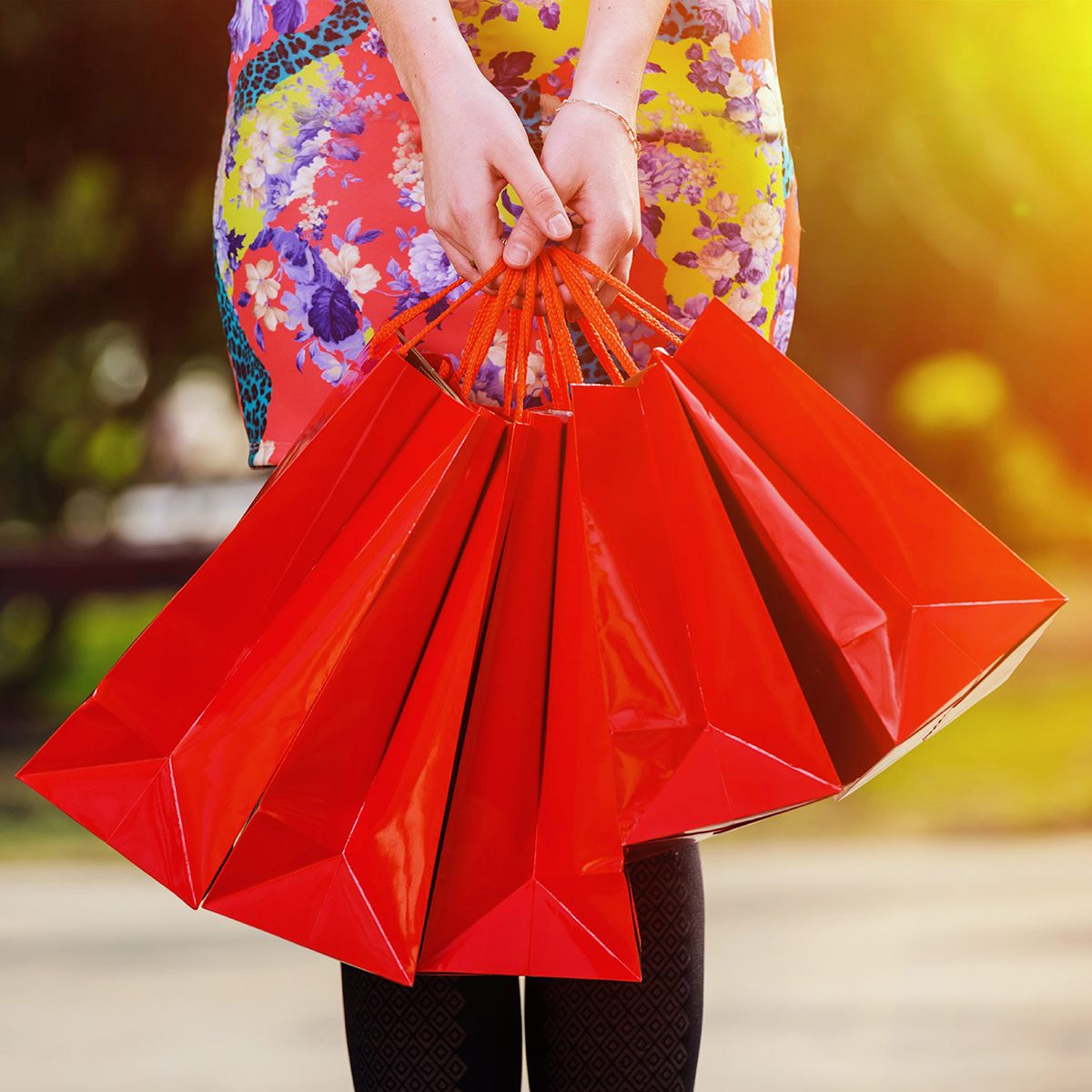 Woman carrying red bags