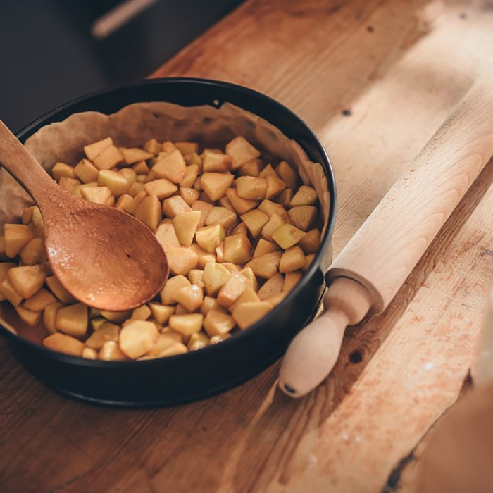 Apple pie filling on wooden table