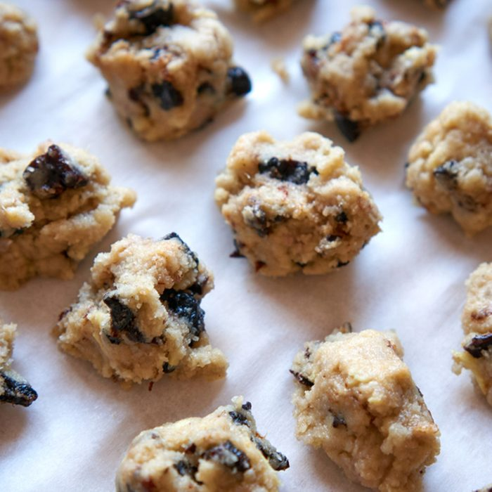 Baking cookies with plums/fruits and prunes on the baking sheet.