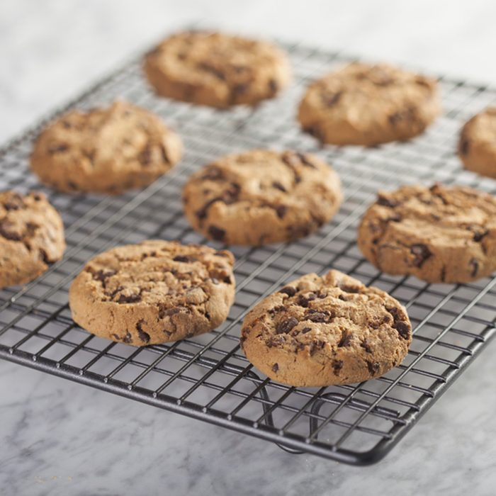 Cookies on a cooling rack over a marble table