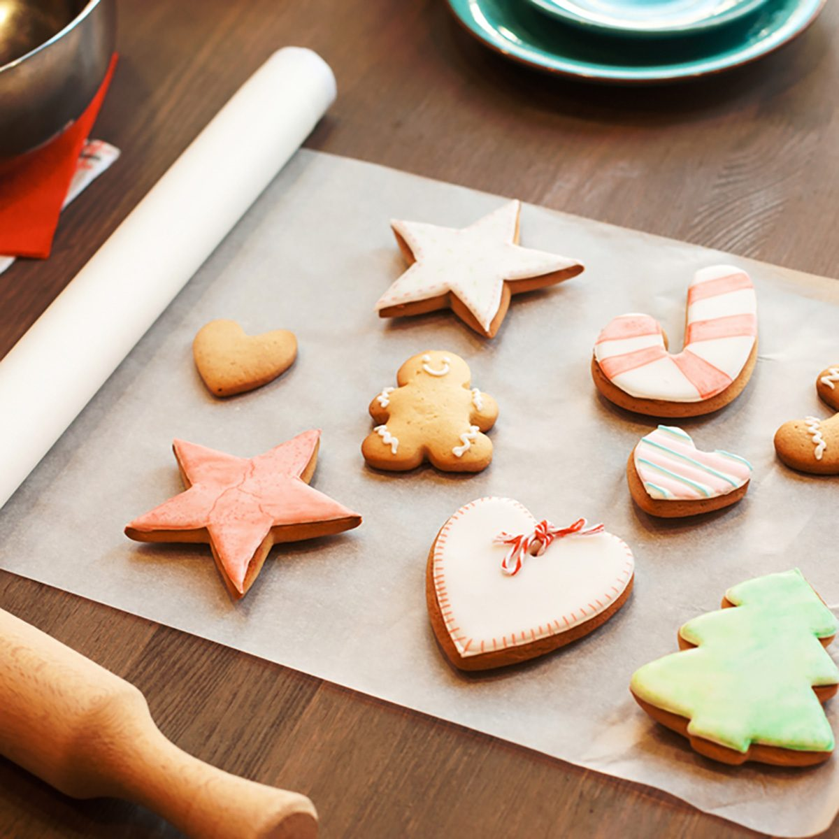 Colorful gingerbread cookies on culinary parchment.