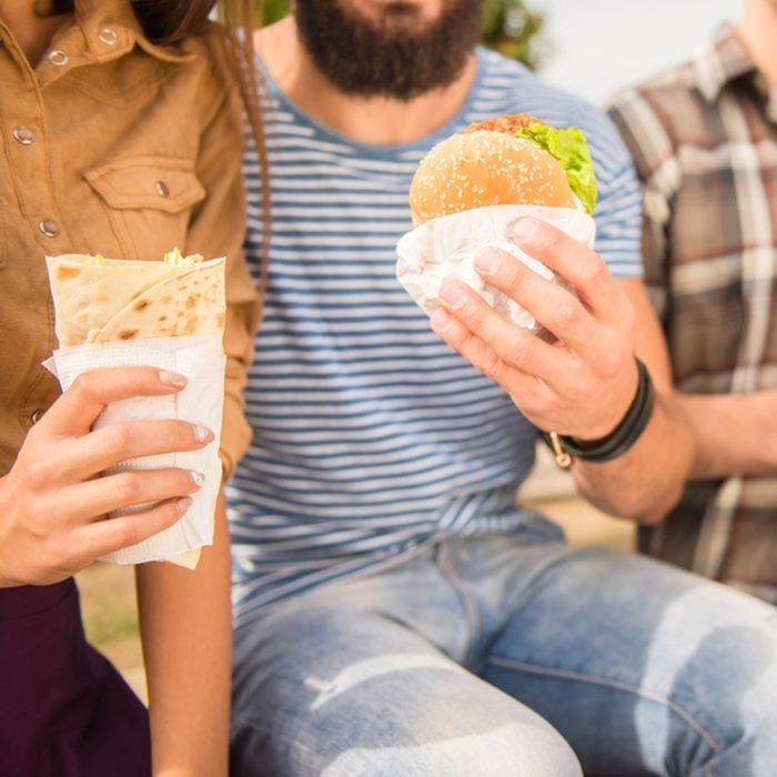 Sitting in the park and eat fast food