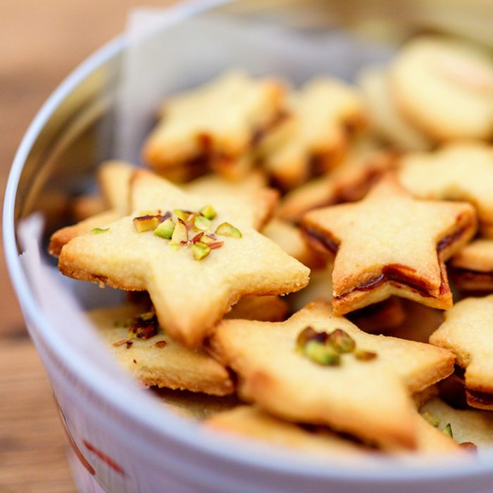 Freshly baked homemade Christmas cookies in a tin box