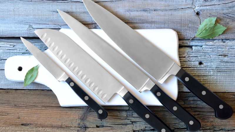 Set of kitchen knives on a board