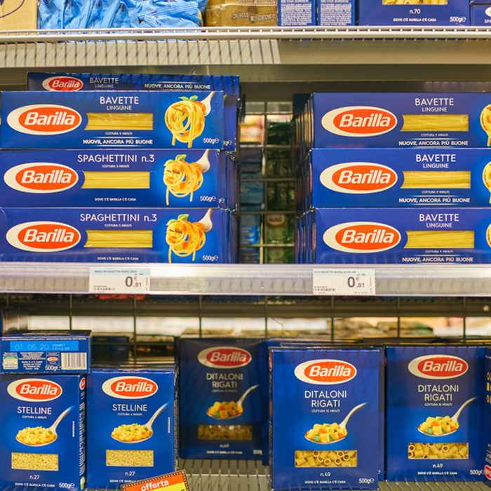 assortment of pasta on display for sale at Carrefour Express in Milan.