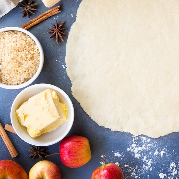 Making apple pie for autumn baking concept,pie dough in center with dessert ingredients