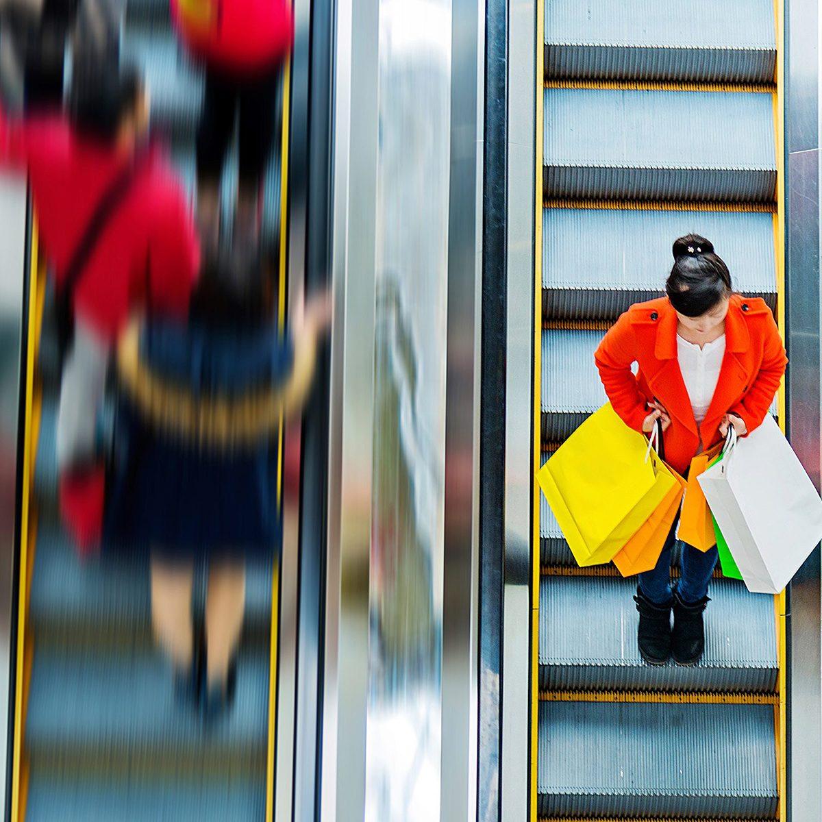 Shoppers on escalators