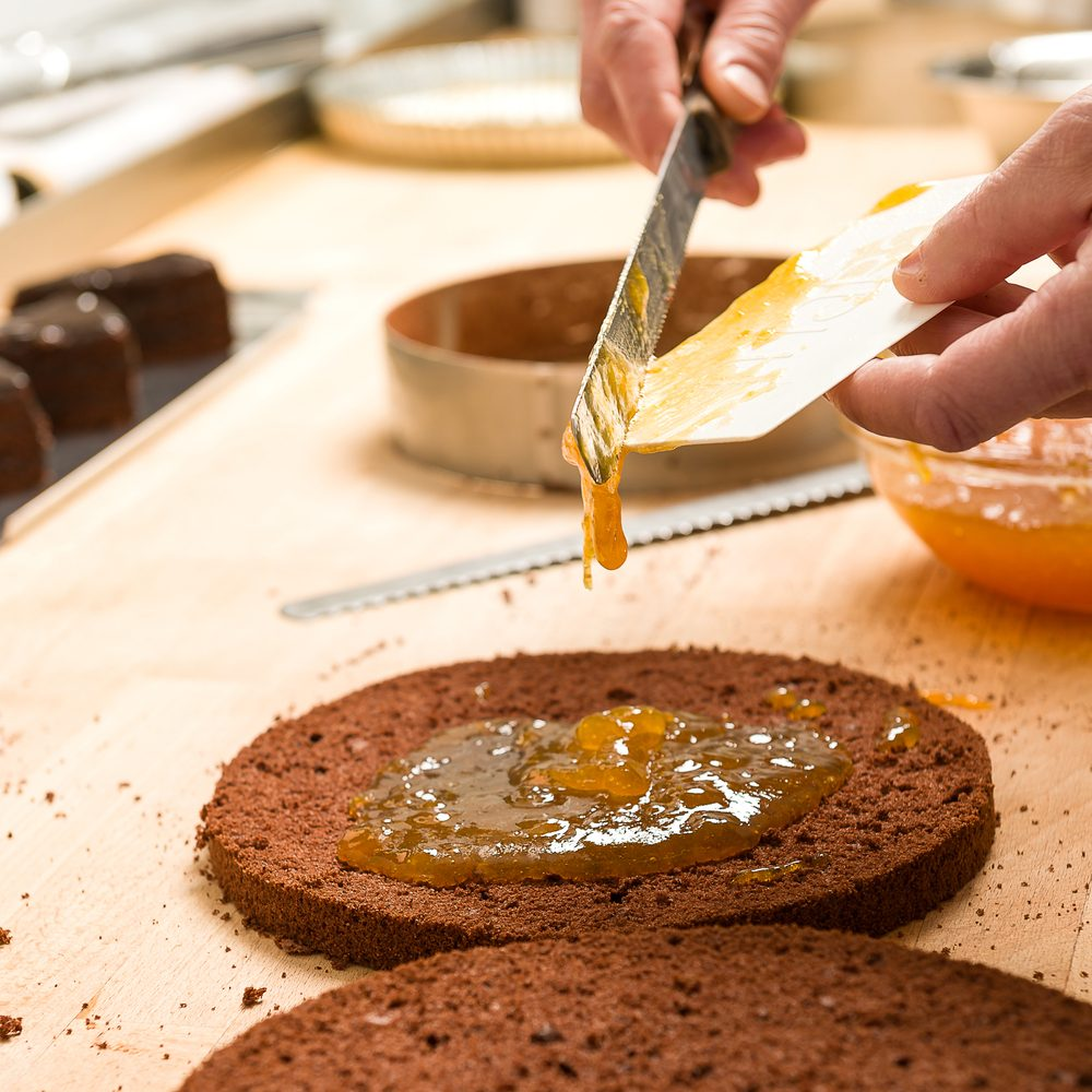 Cook making layer chocolate cake with orange marmalade; Shutterstock ID 134874809; Job (TFH, TOH, RD, BNB, CWM, CM): Taste of Home