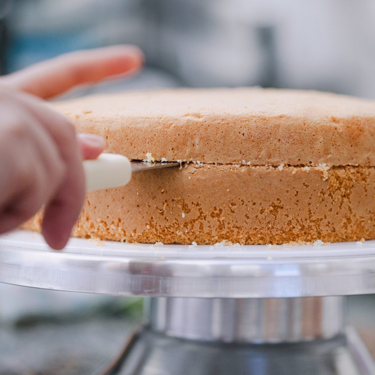 Confectioner cutting the cake to prepare; Shutterstock ID 624975419; Job (TFH, TOH, RD, BNB, CWM, CM): Taste of Home