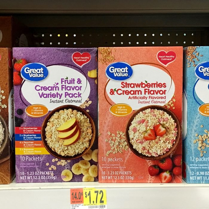 Grocery store shelf with boxes of Great Value generic flavored instant Oatmeal packages. Great Value is a Walmart brand product.