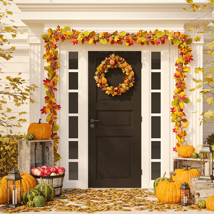 3d rendering. autumn decorated house with pumpkins and hay.;