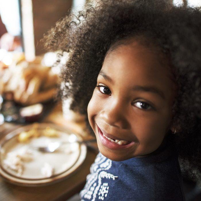 Little Girl Eating Thanksgiving Celebration