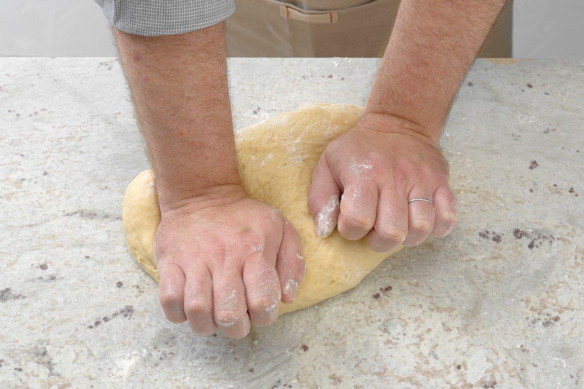 Kneading Dough On Floured Surface
