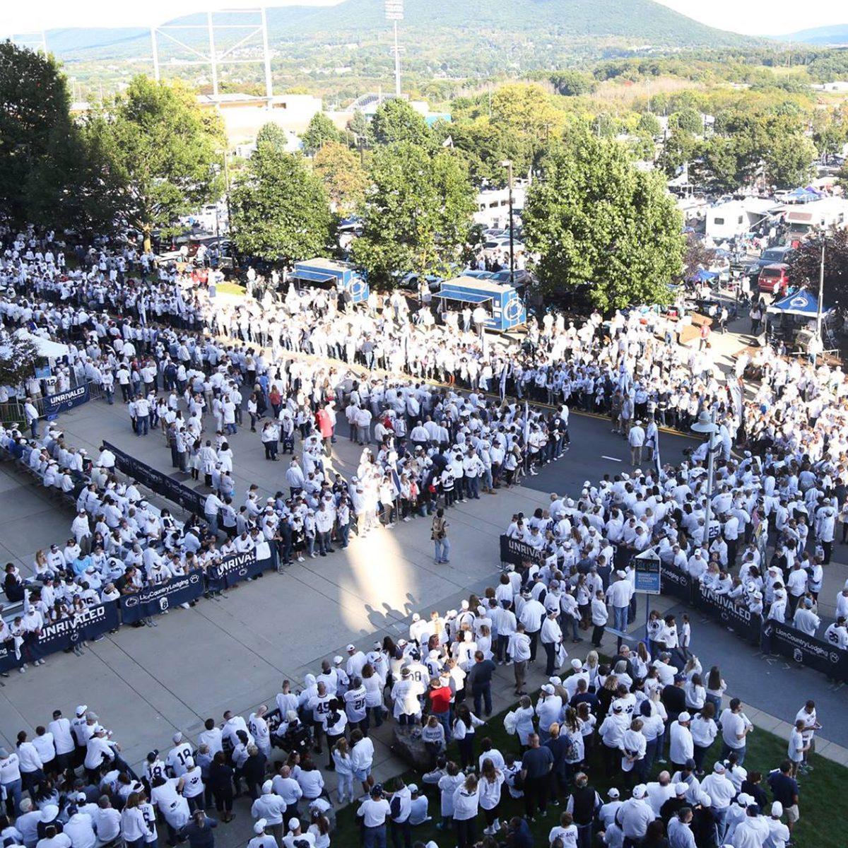 Penn State Football fans line the street