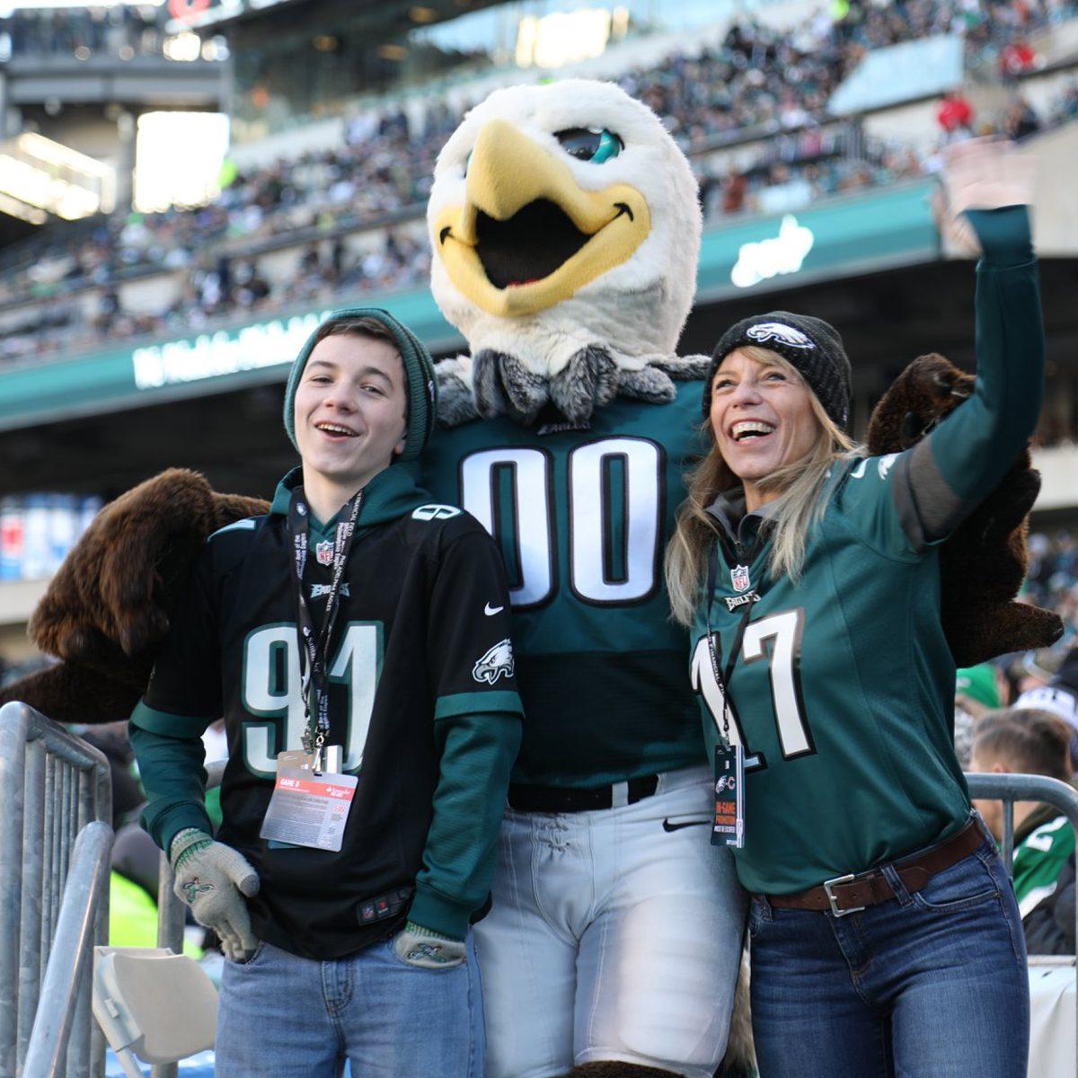Philadelphia Eagles fans posing with mascot
