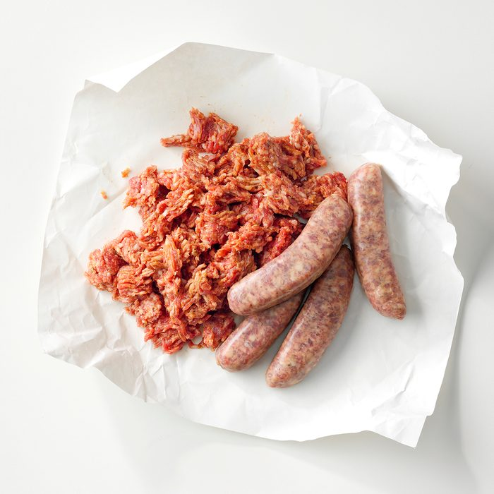 Parchment paper with ground and link Italian sausage