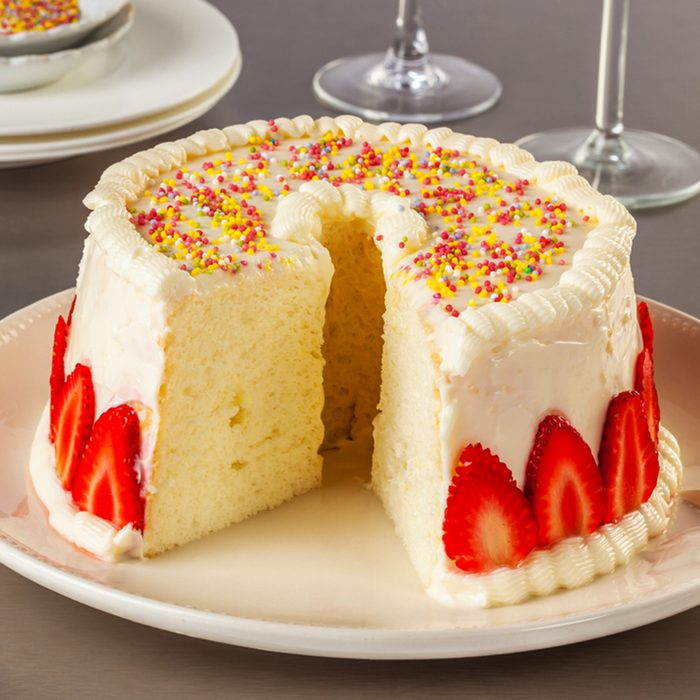 Angel food cake, or angel cake, is a type of sponge cake made with stiffly beaten egg whites with no addition of butter.; Shutterstock ID 451955008; Job (TFH, TOH, RD, BNB, CWM, CM): TOH