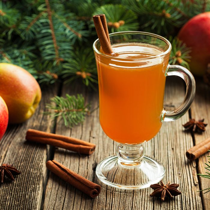 Hot apple cider traditional winter season drink with cinnamon and anise. Homemade healthy organic warm spice beverage. Christmas or thanksgiving holiday decoration on vintage wooden background.; Shutterstock ID 337633124; Job (TFH, TOH, RD, BNB, CWM, CM): TOH