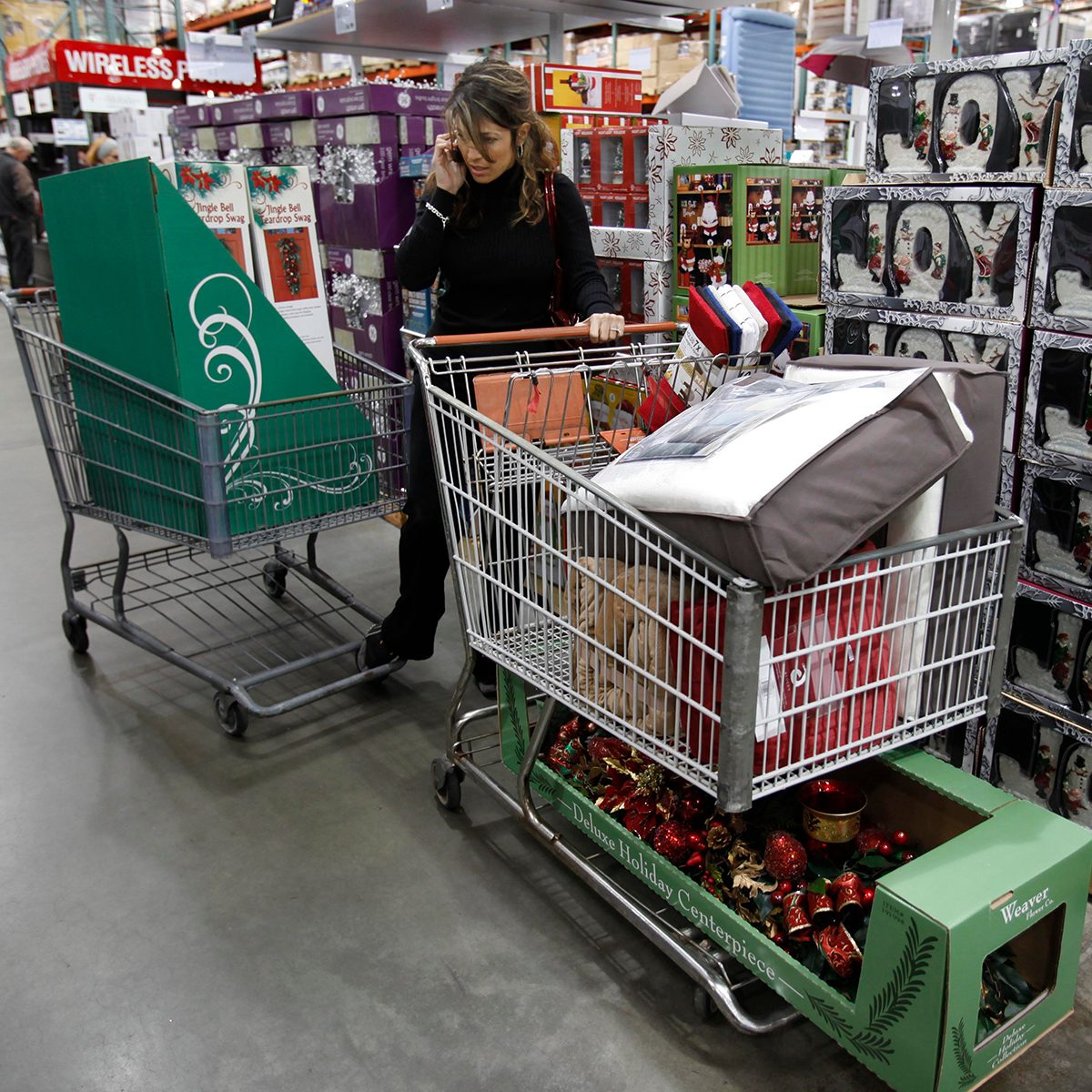Shopper with two loads of Christmas items at Costco in Mountain View, Calif