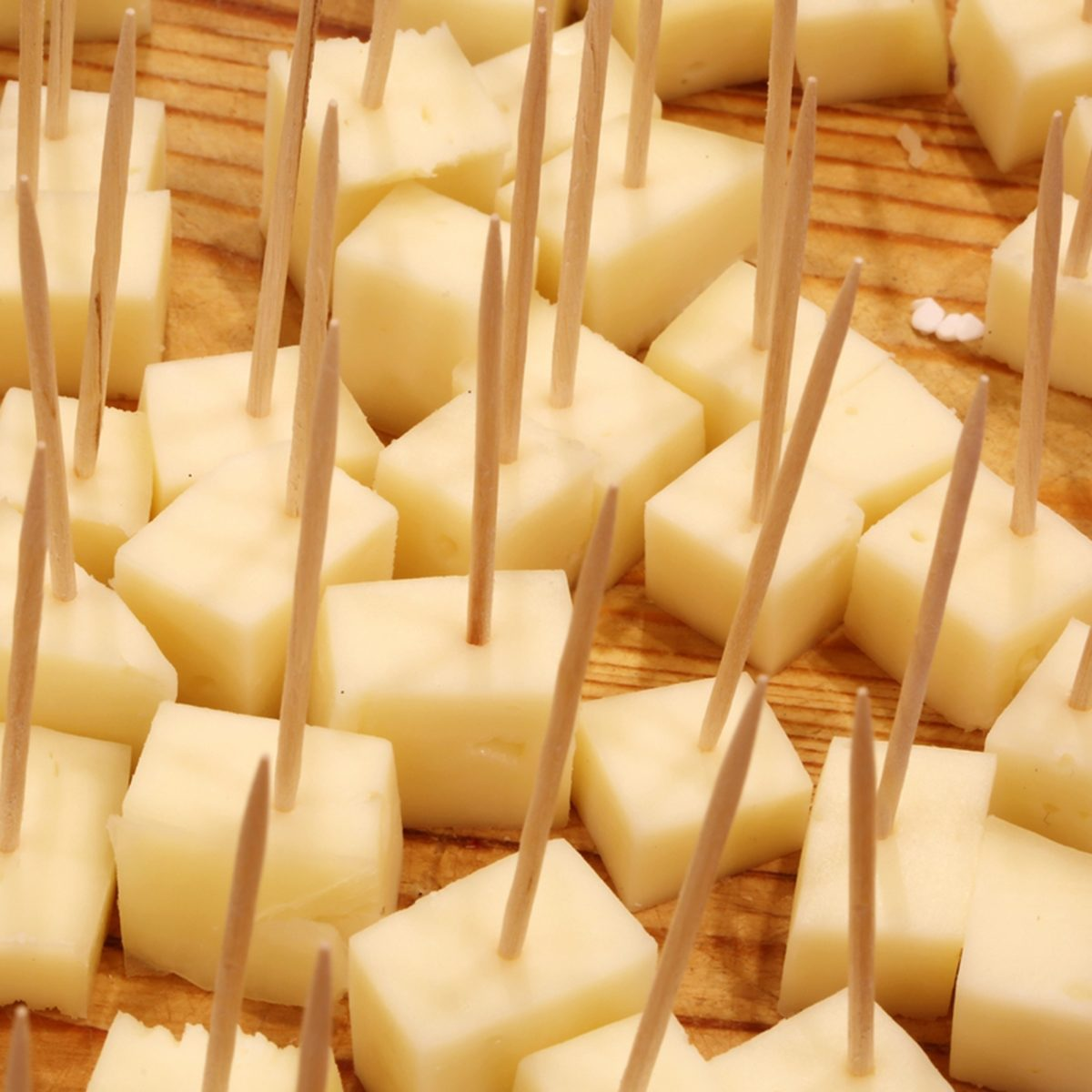 fresh cheese tastings with toothpicks in the cheese shop over the cutting board