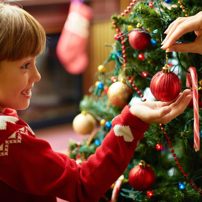 Child being presented an ornament