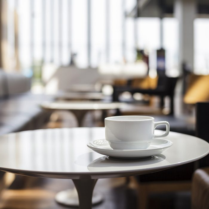 Coffee Cup on table Cafe shop Interior Blur people background