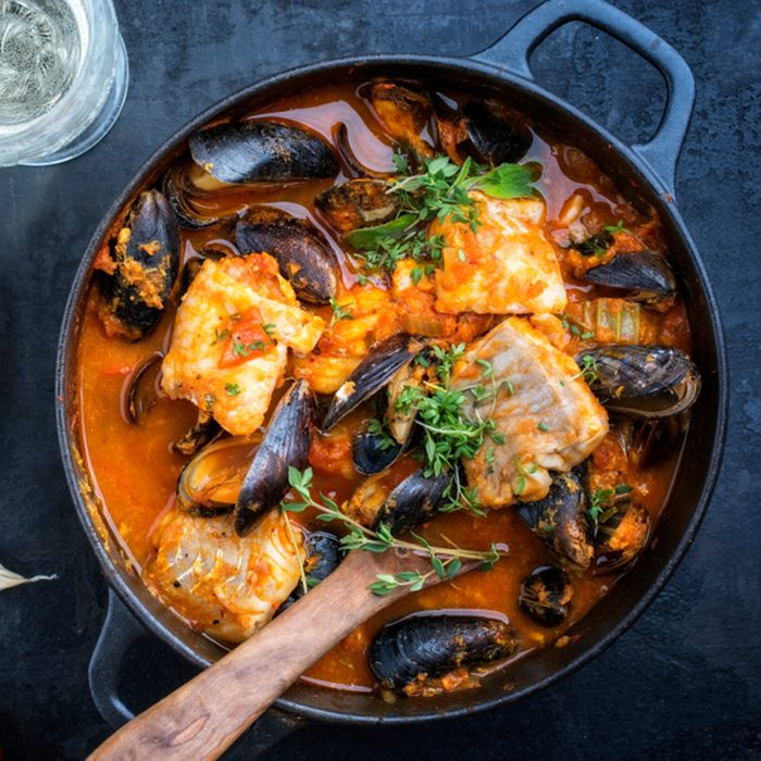 Traditional French Corsican fish stew with mussels and garlic baguette as top view in a pot; Shutterstock ID 1060620911; Job (TFH, TOH, RD, BNB, CWM, CM): TOH
