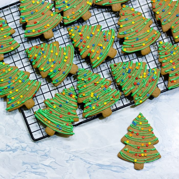 gingerbread cookies with green icing and colorful sugar sprinkles shaped Christmas tree for kids winter holiday treat
