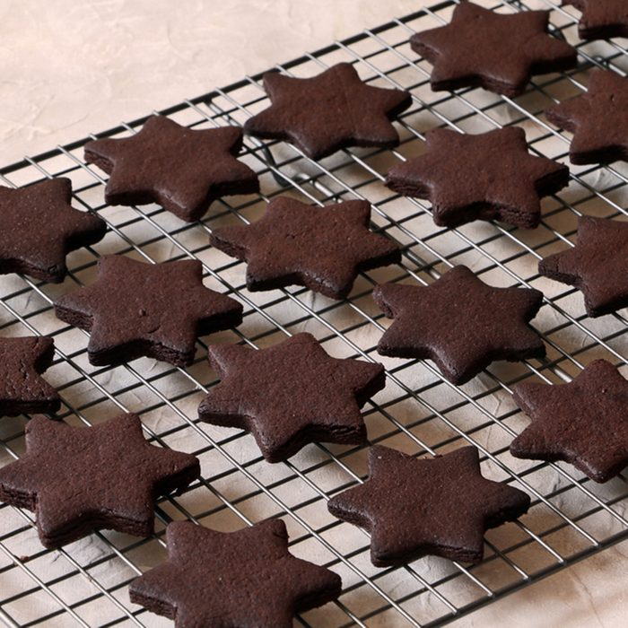 Sugar chocolate cookies on wooden background, top view.