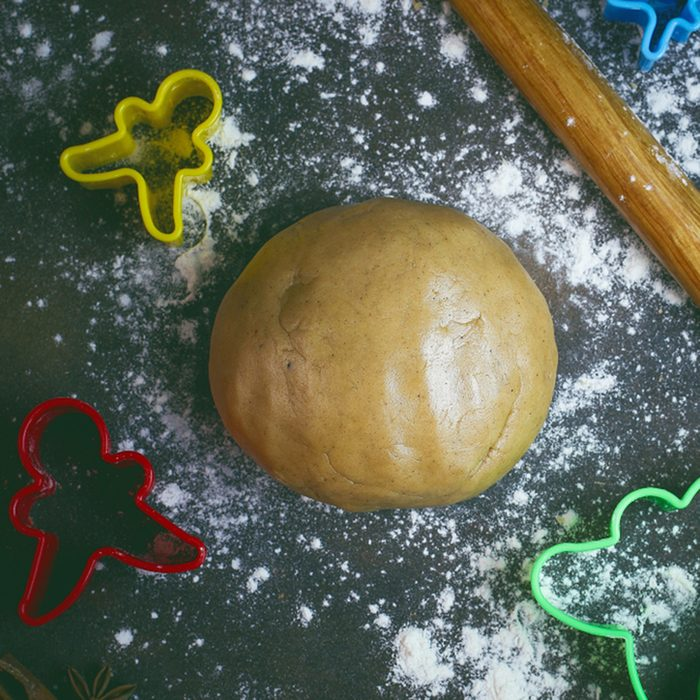 gingerbread cookie dough and gingerbread man cookie cutter making process