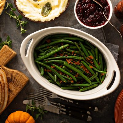 Green beans with bacon, side dish for Thanksgiving or Christmas dinner overhead shot; Shutterstock ID 735091258