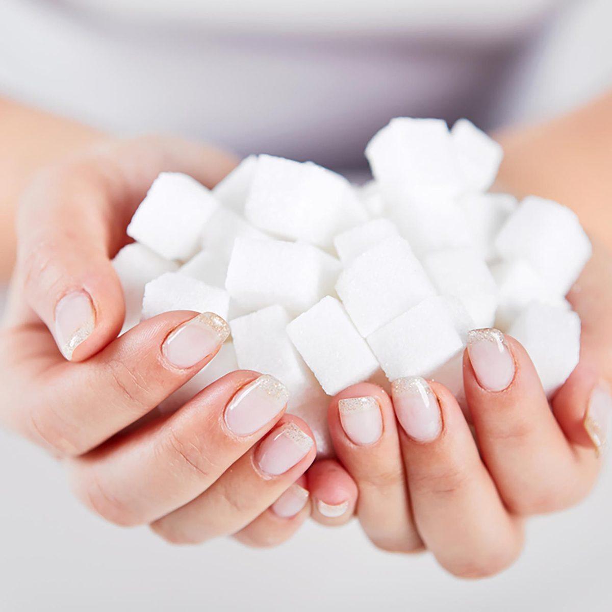 Woman holding sugar cubes