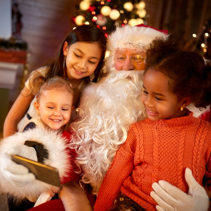Santa Claus sharing smart phone with children in Christmas atmosphere; Shutterstock ID 514808041; Job (TFH, TOH, RD, BNB, CWM, CM): TOH