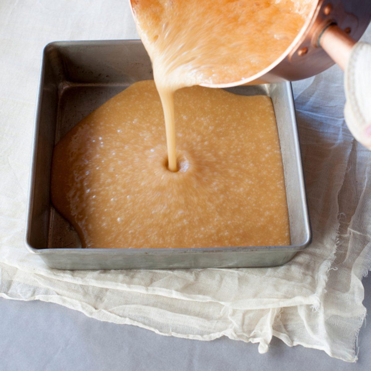 Pouring homemade caramel into pan; Shutterstock ID 1176955333; Job (TFH, TOH, RD, BNB, CWM, CM): TOH