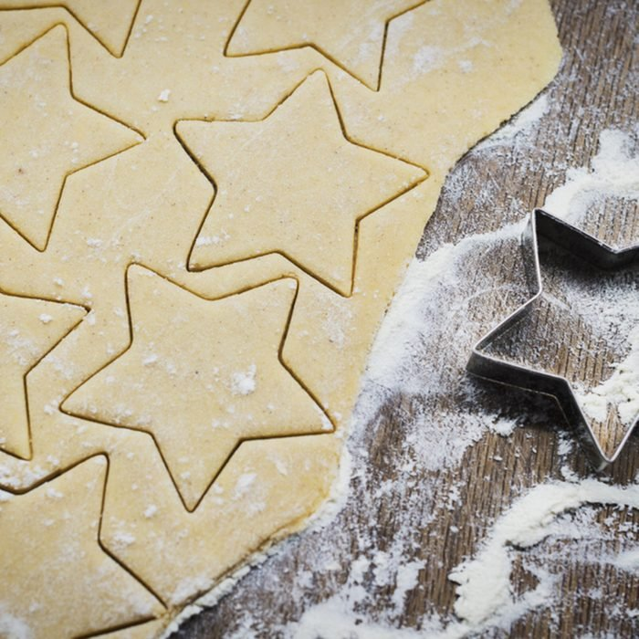 Christmas baking. Making gingerbread biscuits. Cookie dough and cookie cutters on kitchen counter, top view.; Shutterstock ID 1187249365; Job (TFH, TOH, RD, BNB, CWM, CM): Taste of Home