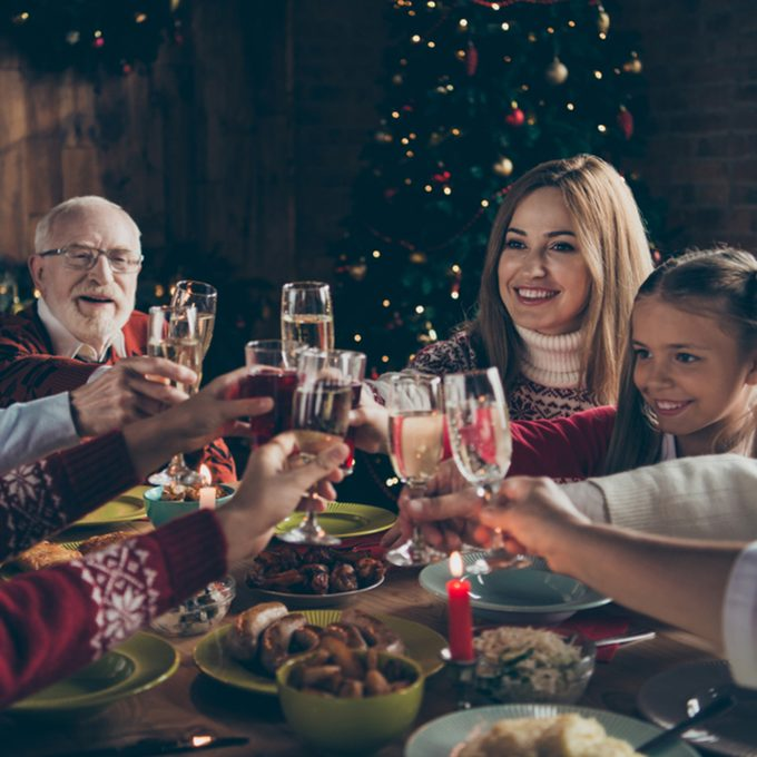 Noel evening family gathering, meeting, congrats. Cheerful grey-haired grandparents, grandchildren, daughter, son, relatives sitting at table, house party, navidad, eating dinner homemade food fun; Shutterstock ID 1190688700; Job (TFH, TOH, RD, BNB, CWM, CM): TOH