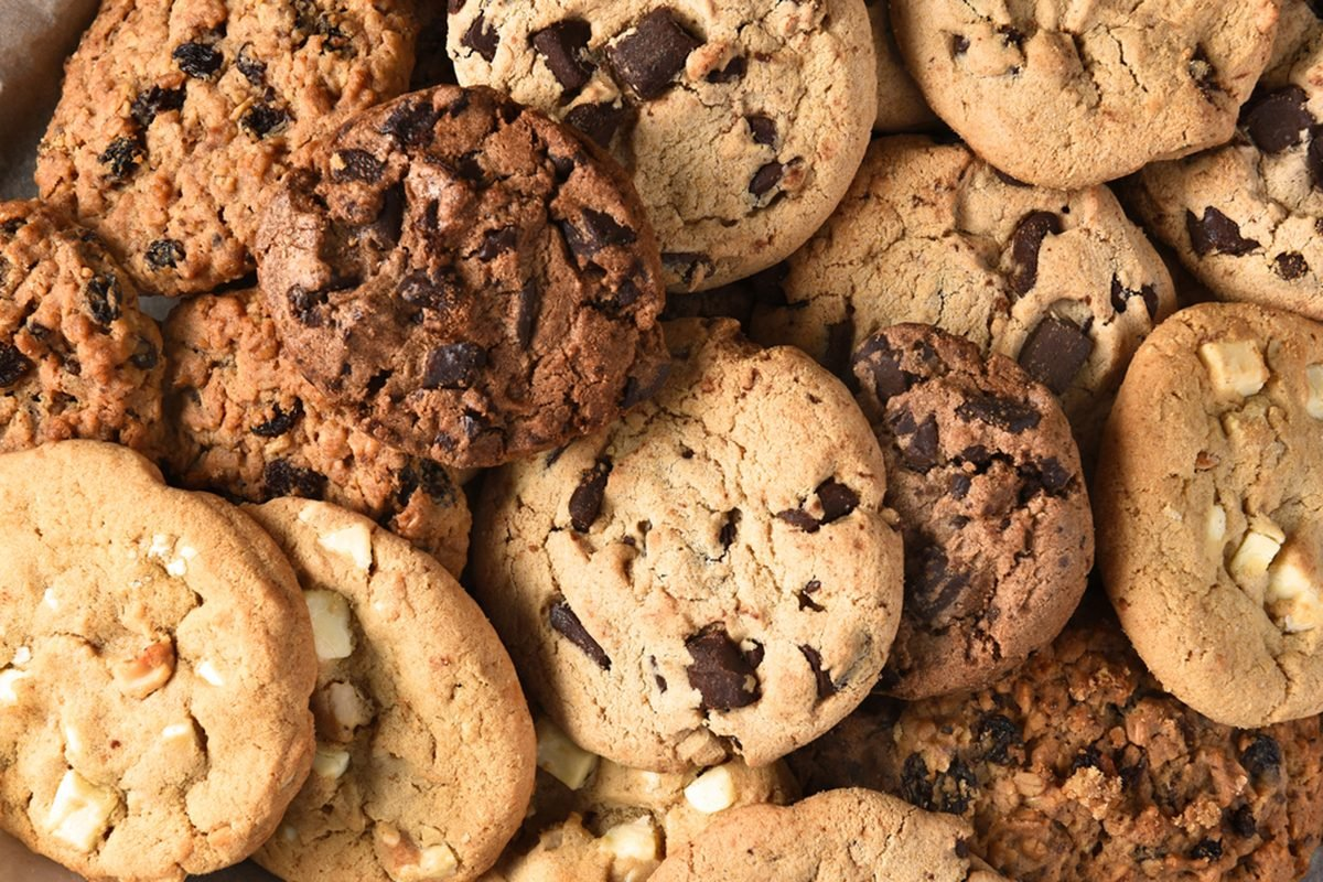 Closeup of a group of assorted cookies. Chocolate chip, oatmeal raisin, white chocolate fill the frame.; Shutterstock ID 340939574