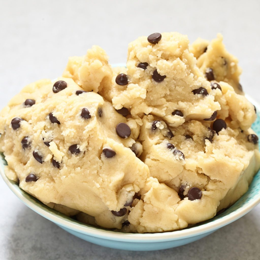 Sweet cookie dough with chocolate chips on a table; Shutterstock ID 465142328; Job (TFH, TOH, RD, BNB, CWM, CM): Taste of Home