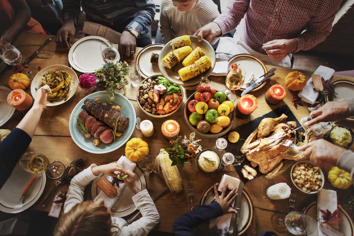 People Celebrating Thanksgiving Holiday Tradition Concept; Shutterstock ID 493381651