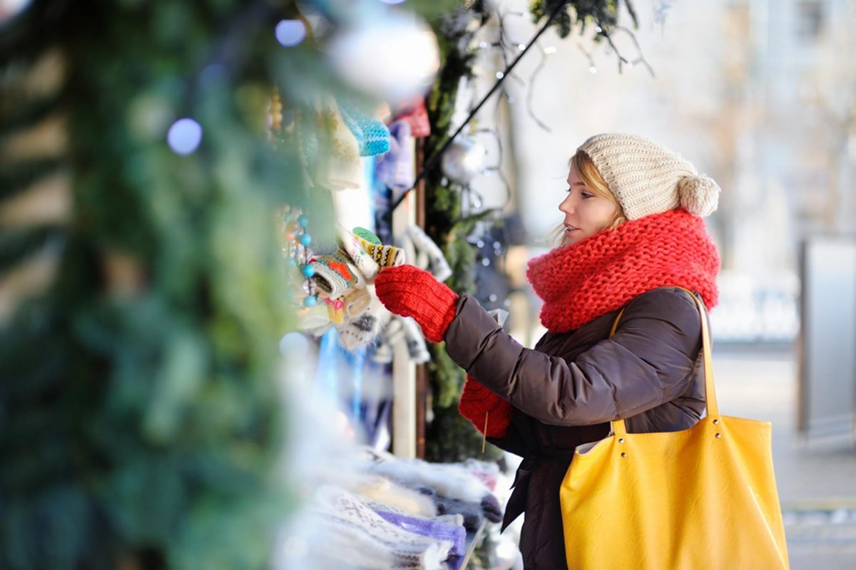 woman shopping at stores open on christmas day in the snow