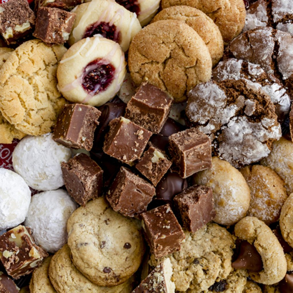 Holiday gift platter filled with homemade cookies and candies ready for gifting; Shutterstock ID 551370295