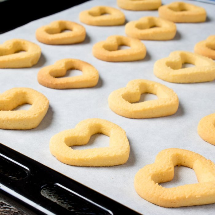 Butter cookies heart-shaped on a cookie sheet, fresh from the oven; Shutterstock ID 591182369; Job (TFH, TOH, RD, BNB, CWM, CM): Taste of Home