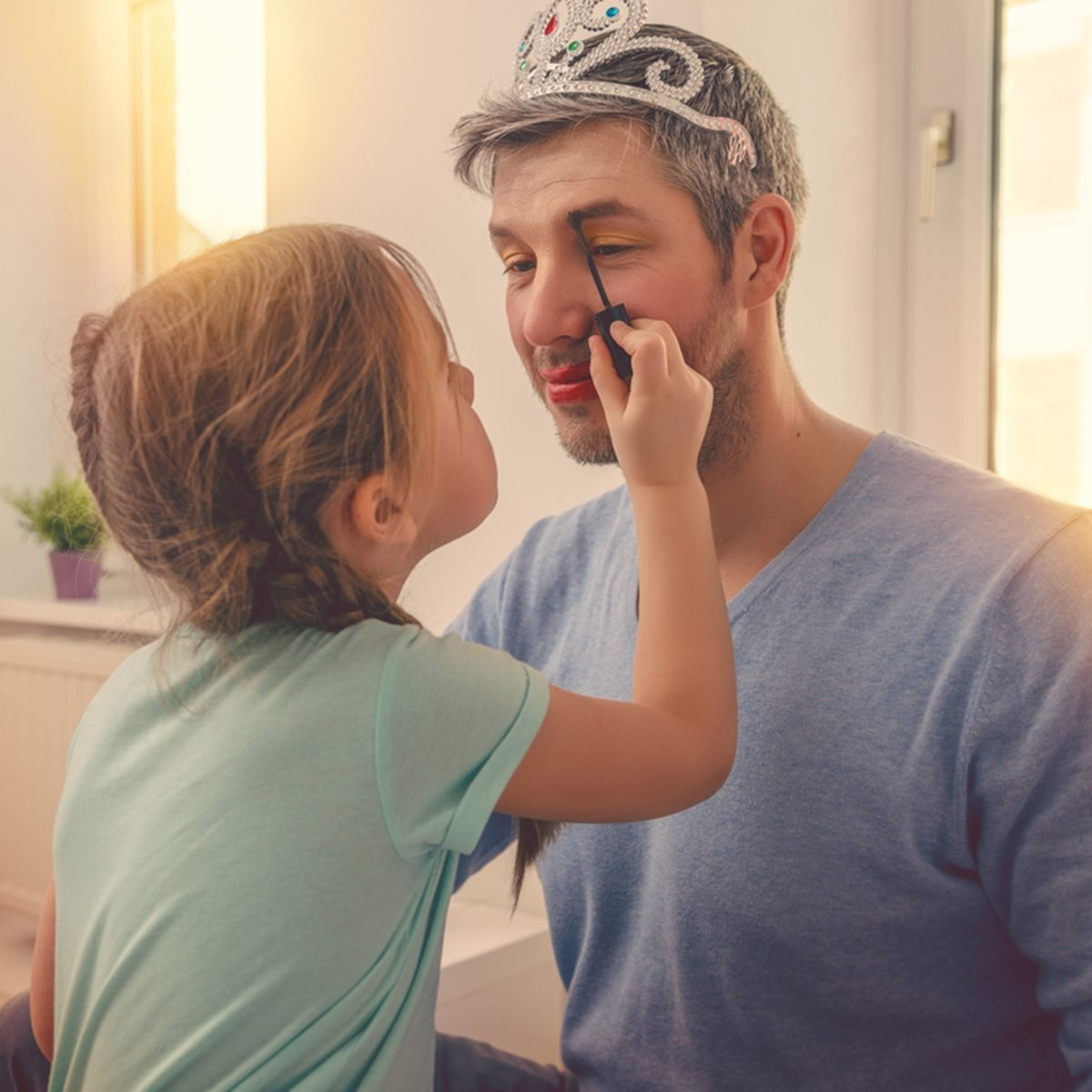 dad with cute daughter beeing treated with lipstick for carnival; Shutterstock ID 603110969; Job (TFH, TOH, RD, BNB, CWM, CM): TOH