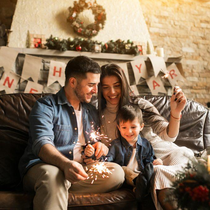 Family on Christmas with bengal lights; Shutterstock ID 745825180; Job (TFH, TOH, RD, BNB, CWM, CM): TOH
