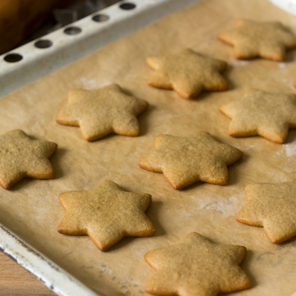 Baked gingerbread on baking sheet without decoration. Selective focus.; Shutterstock ID 777279445; Job (TFH, TOH, RD, BNB, CWM, CM): Taste of Home