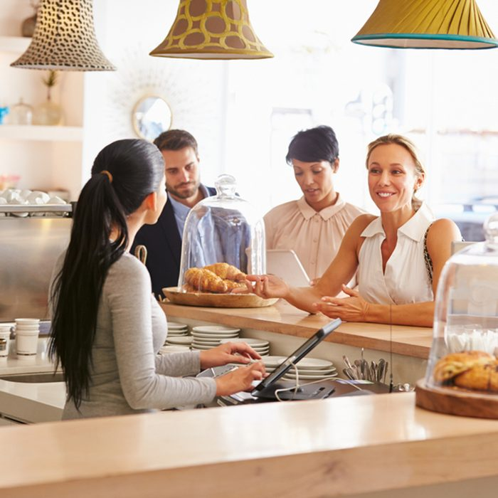 Woman ordering at the counter in a cafe