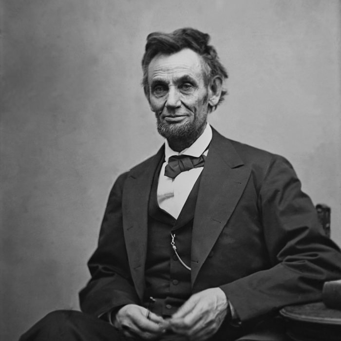 Abraham Lincoln (1809-1865) seated and holding his spectacles and a pencil on Feb. 5, 1865 in portrait by Alexander Gardner.